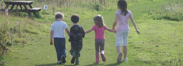 Children playing in rural park