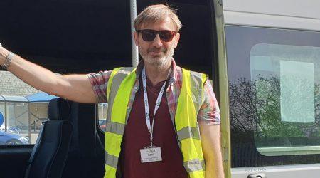 A smiling Door 2 Door minbus driver