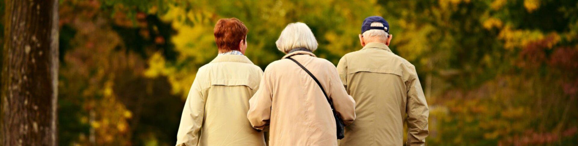 Three older people walking