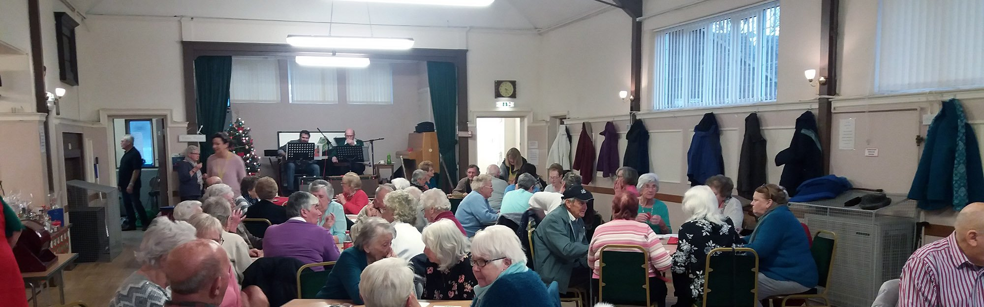 People meeting in a village hall