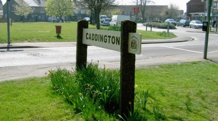 Caddington village road sign