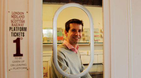 Smiling man at Ridgmont station ticket office