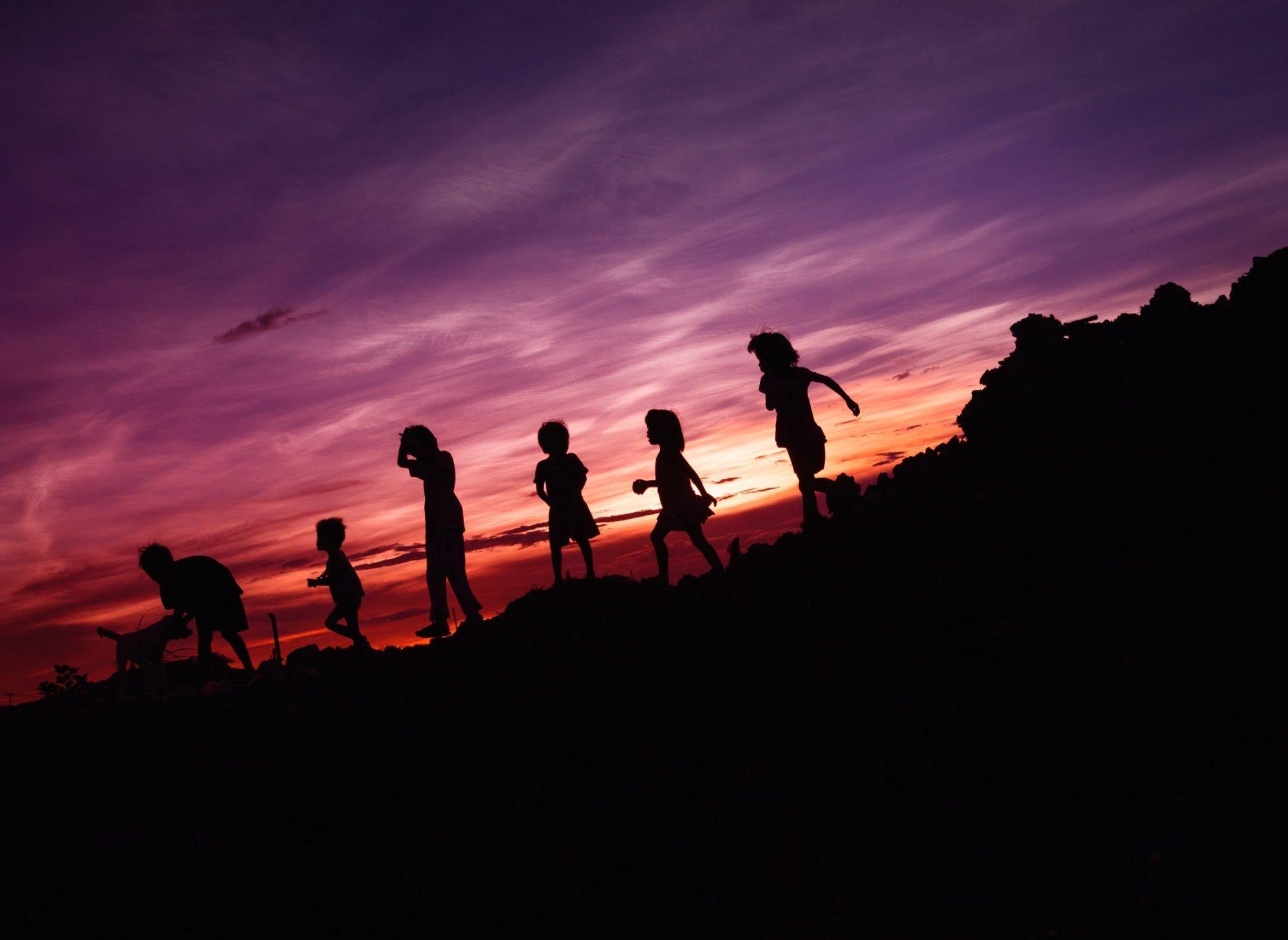 Group of children walking outside