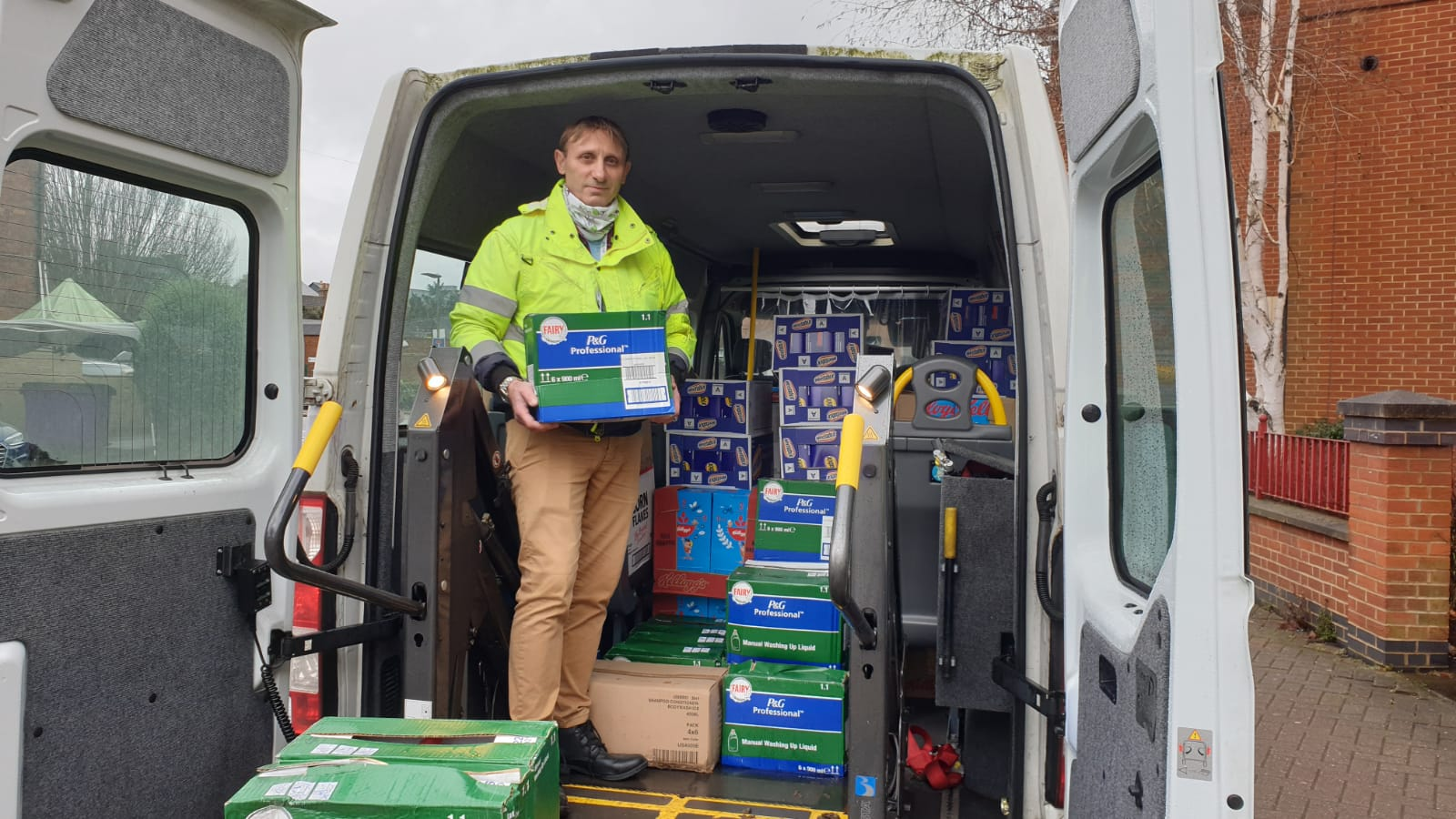 Community transport bus and driver delivering supplies
