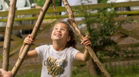 Little girl holding sticks