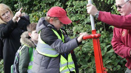 Children having demonstration of railway points