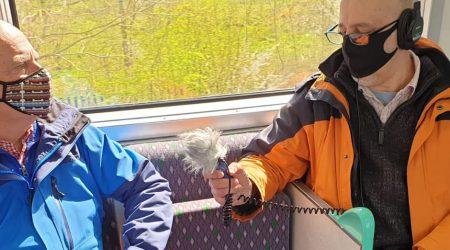Man being interviwed in a train